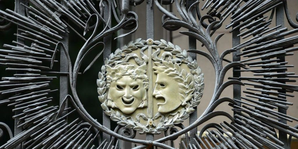 Iron Railings And The Two Masks Associated With Comedy and Tragedy Close Up On The Exterior Of The Players Club Near Union Square Park New York City