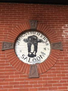 Hogs & Heifers Saloon Sign