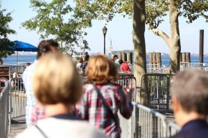 A photo of a small group tour ear the Statue of Liberty.